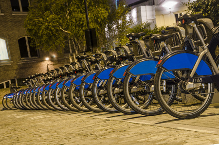 dependance: London City Bike Rental -  Row of bikes for hire as part of a new scheme to encourage  pedal power  in the City of London. The aim is to reduce dependance on cars and thereby reduce London Editorial