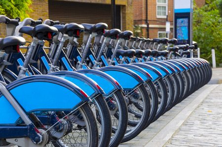 dependance: City Bike Rental -  a row of bikes for hire as part of a new scheme to encourage  pedal power  in the City of London.  The aim is to reduce dependance on cars and thereby reduce London