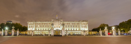 Buckingham palace in London at night panorama