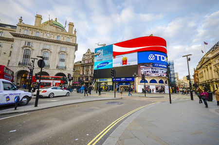 junctions: People at Piccadilly Circus in London A landmark of London,the circus is a favorite place for people to congregate before going to the nearby shopping and entertainment areas Editorial