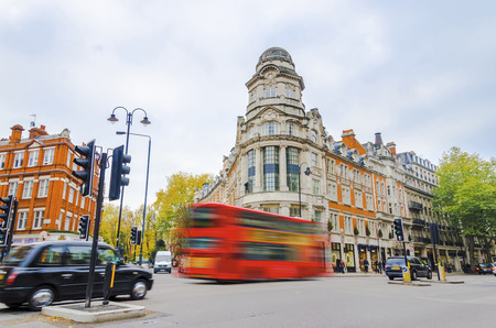 taxi famous building: Traditional London street with public transportation of double decker bus and taxi cab
