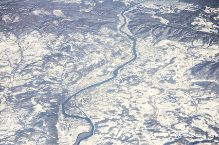 Aerial view of mountains and frozen river, Alps photo