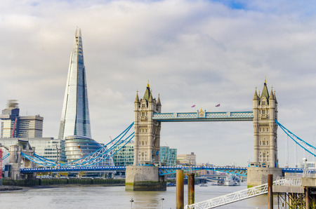 The Shard and Tower Bridge on Thames river in London, UK
