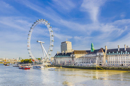 London morning with London eye millennium wheel and ferries