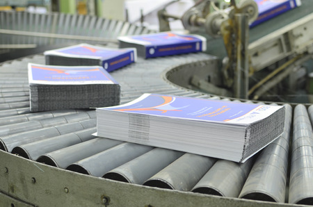 Close-up of the offset conveying process of a full-automatic perfect bound stitching unit Фото со стока - 27539568