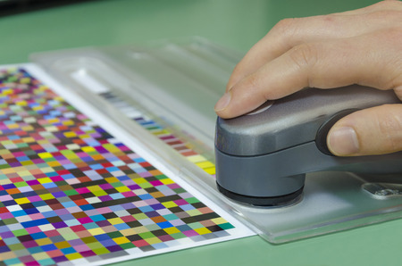 spectrophotometer: spectrophotometer measurment of color patches on Test Arch, print plant prepress department
