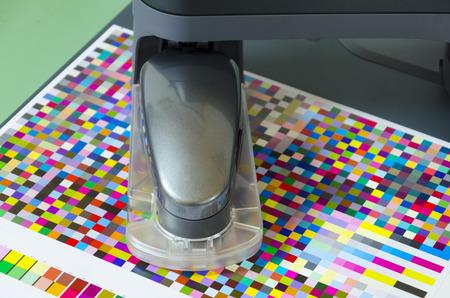 icc profile, spectrophotometer robot measures color patches on Test Arch, Press shop prepress department