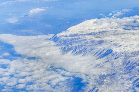 sunshines: The Alps in winter out of the plane, Aerial Panorama Stock Photo