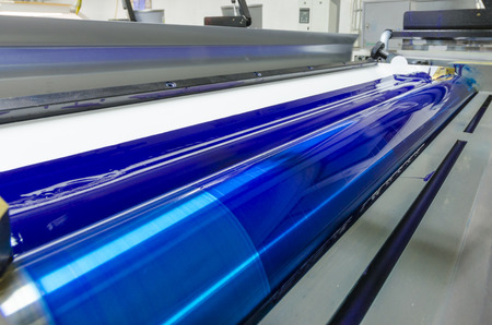 cian: print machine printing press rollers, cyan, blue color drum, dramatic light