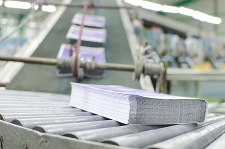 Print shop (press printing) - Finishing line. Post press finishing line machine: cutting, trimming, paperback and binding