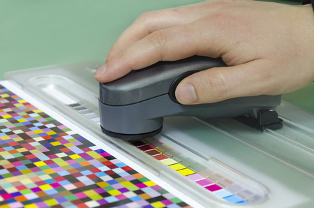 spectrophotometer: spectrophotometer verify color patches on Test Arch, Press shop prepress department Stock Photo