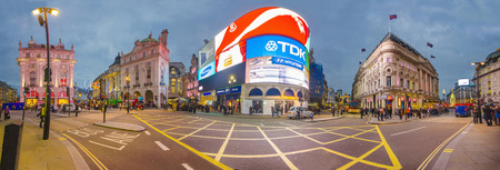 LONDON, ENGLAND NOV 28: Famous Piccadilly Circus neon signage that has become a major attraction of London on on Nov 28, 2013 in London, United Kingdom. Panorama of new Piccadilly advertisment lights