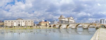 wather: beautiful old stone bridge and archaeological museum of Macedonia, Vardar river wather reflection