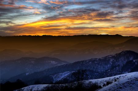 skie: Sunset on the high altitude mountain. High altitude sunset Stock Photo