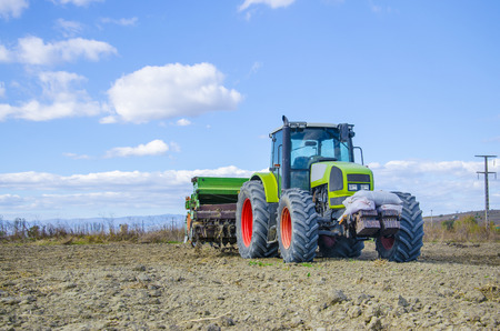fatten: Ploughing heavy tractor during cultivation agriculture works at field with plough