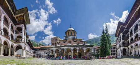 RILA, BULGARIA - circa JUN  Unidentified tourists visit the Unesco Wordl Heritage site and landmark of Rila monastery aka monastery of Saint Ivan of Rila, on circa June, 2014 in Rila, Bulgaria Редакционное