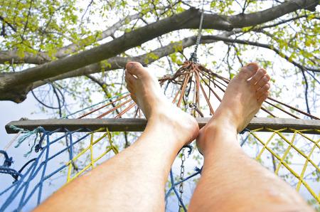 rest in peace: feet in hammock on the beach