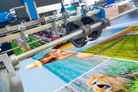 during: Close up of an offset printing machine during production