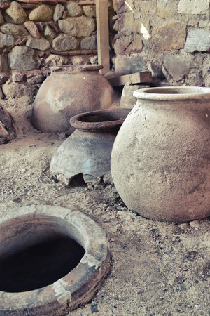 old clay pot excavations into ancient city ruins close up photo