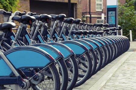 dependance: City Bike Rental - Stock Image, a row of bikes for hire as part of a new scheme to encourage \pedal power\ in the City of London. The aim is to reduce dependance on cars and thereby reduce London