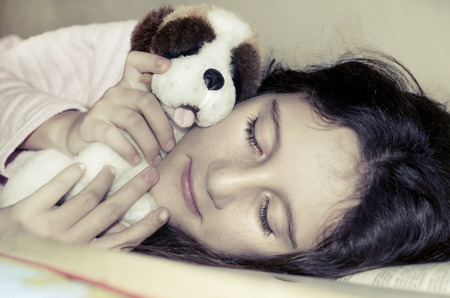 bunkbed: Little sweet girl sleeping in a bed hugging with her toy