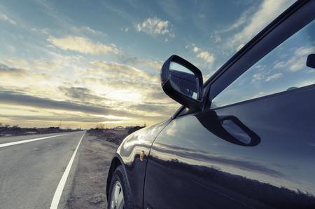 speedy: Sport car ride on road in sunset weather