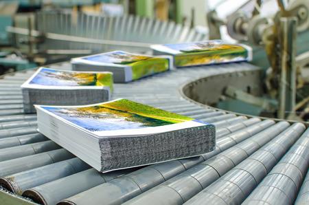 book binding: Print shop (press printing) - Finishing line. Post press finishing line machine: cutting, trimming, paperback and binding