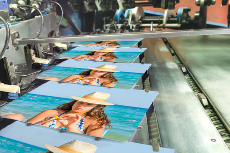 Book, magazine, catalog production line into press plant house. stitching cover with the spline.