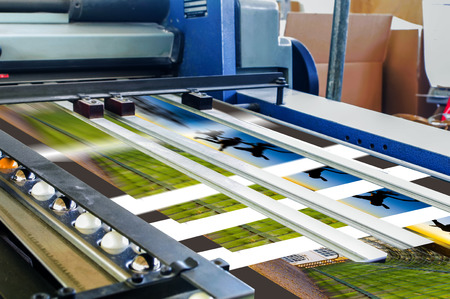 prints: Close up of an offset printing machine during production