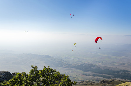 adrenaline: parachute paragliding fly. Adrenaline gliding on high altitude