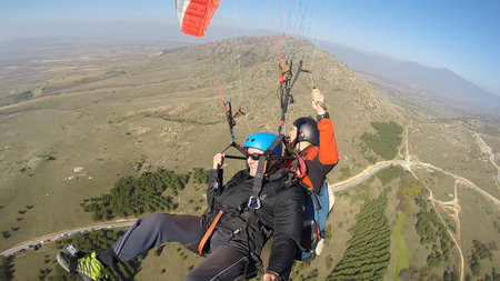 gliding: Tourist tandem paragliding guided by a pilot