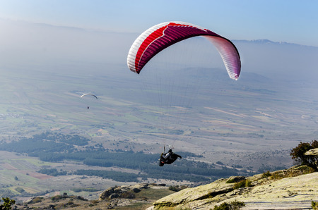 gliding: Paraglider taking off from a mountain