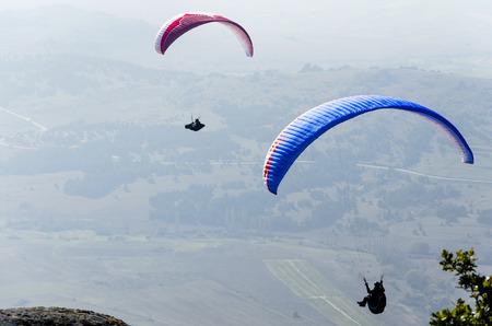 gliding: Extreme sport paraglider gliding Stock Photo
