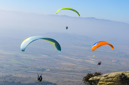 hang glider: Three paragliders fly at day blue sky