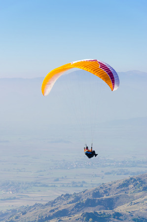 skydive: praglider parachute gliding at high altitude