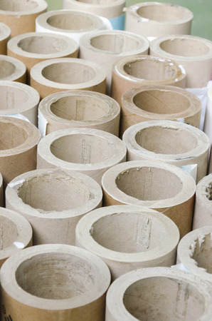Cylinders cardboard background of Rolled paper in offset printing house, vertical photo
