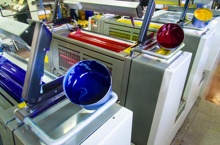 printing inks: offset printing press and ink pot Stock Photo