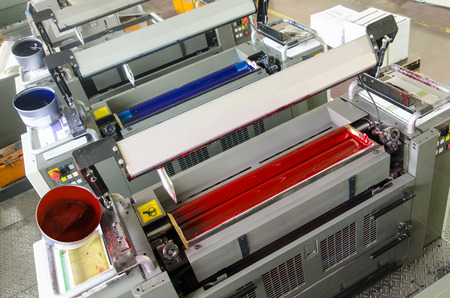 printing machine: printing machine cylinders and printing ink pot Stock Photo