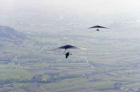 adrenaline: Aerial view of two pilot gliders doing gliding as extreme adrenaline sport