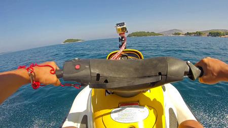 personal watercraft: Extreme Jet Ski Driving  Operator Point of View. Man Riding a Jet Ski Stock Photo