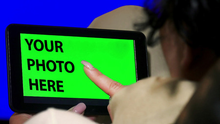 green screen: Green screen hands using digital tablet touchscreen device, holding tablet screen touchpad woman Stock Photo