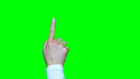 green screen: Hand gestures. Touchscreen. Female hand showing multitouch gestures in green screen Stock Photo