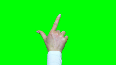 hand gestures: Hand gestures. Touchscreen. Female hand showing multitouch gestures in green screen Stock Photo