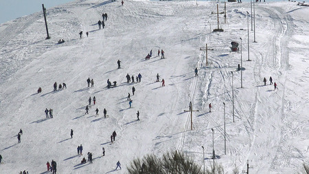 slopes: Skiers at the ski slope mountain top, snowy peaks of the Alps