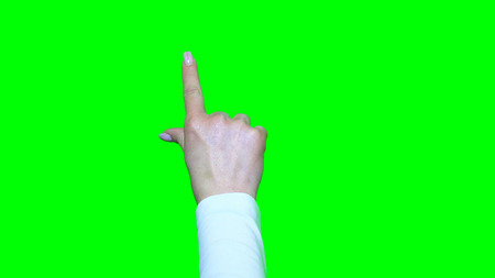 multitouch: Hand gestures. Touchscreen. Female hand showing multitouch gestures in green screen Stock Photo
