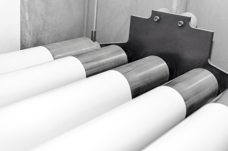 jobbing: Polygraphic process in a modern printing house with rollers and roll print paper Stock Photo