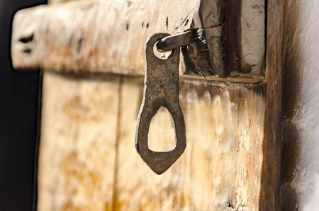 Old wooden door with metallic doorlock Stock Photo