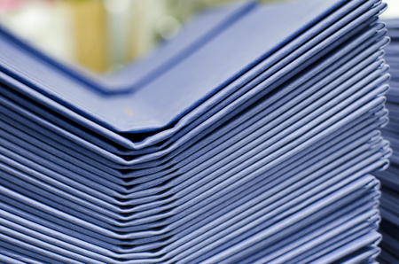 periodical: Many hard book covers stacked in a pile in offset pring production plant Stock Photo