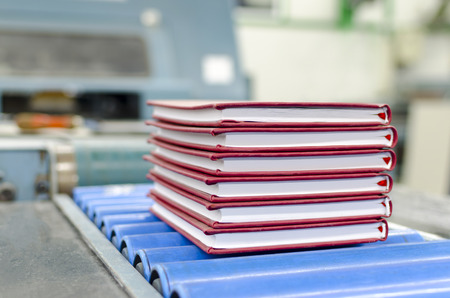book, magazine production line into press plant house. Binding product