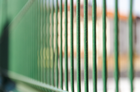 A perspective view of iron jail cell bars Stock Photo